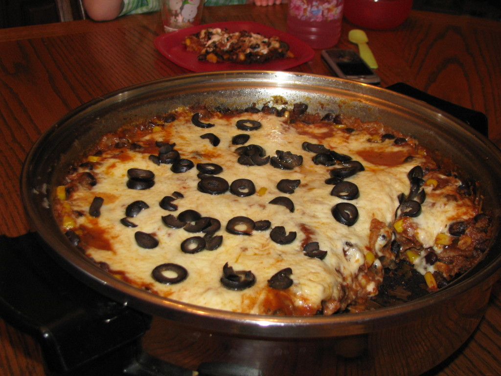 Enchilada Lasagna in the electric skillet.